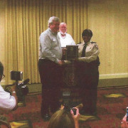 Don Golden presents Cpl. Maxine Evans with the Corrections Officer of the Year Award